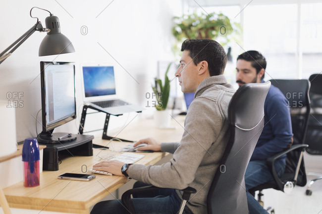 Young man working on a computer in the office