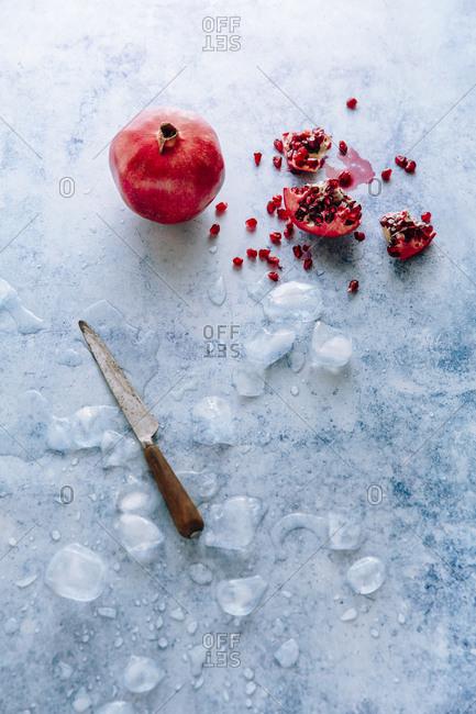 pomegranate with knife still life