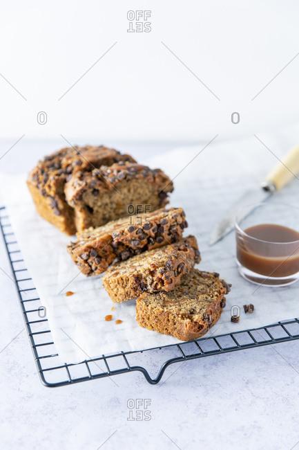 chocolate chip banana bread on a baking rack