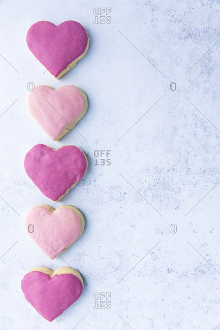 pink heart shaped cookies on light blue