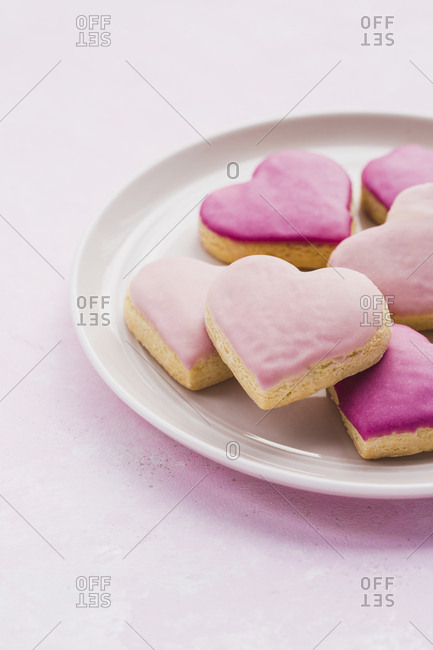 plate of pink heart shaped cookies