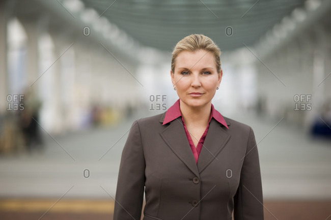 Portrait of a confident mid-adult business woman standing in the city.