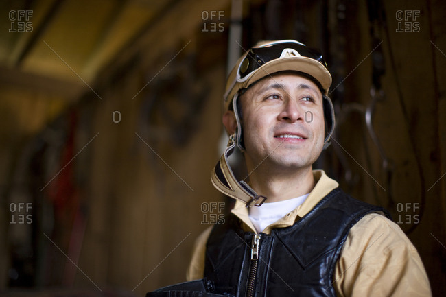 Portrait of man in a stable