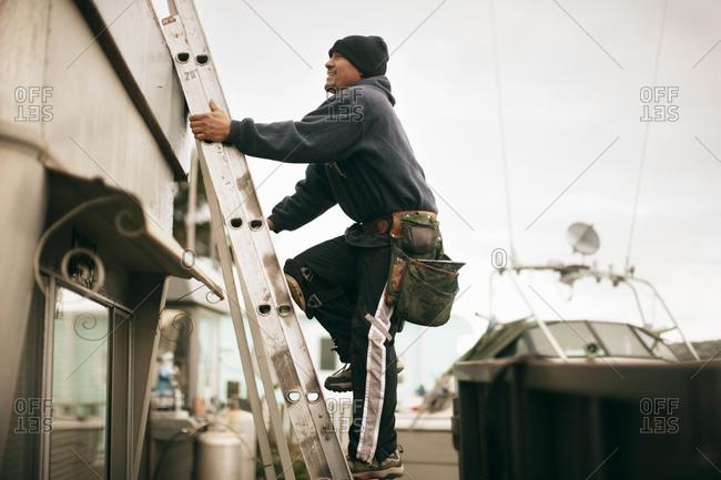 Builder climbing ladder