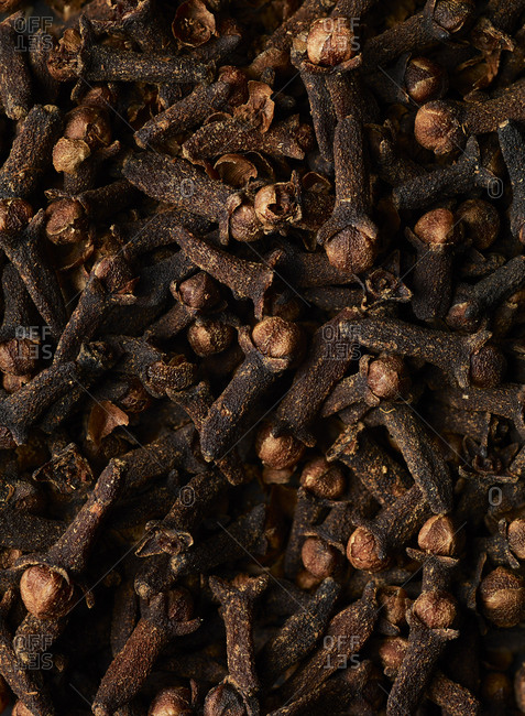A pile of cloves filling the frame, close up macro shot.