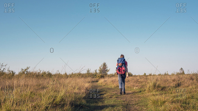 Man hiking with a backpack in a field
