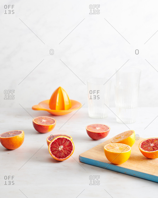 Cut oranges on marble counter