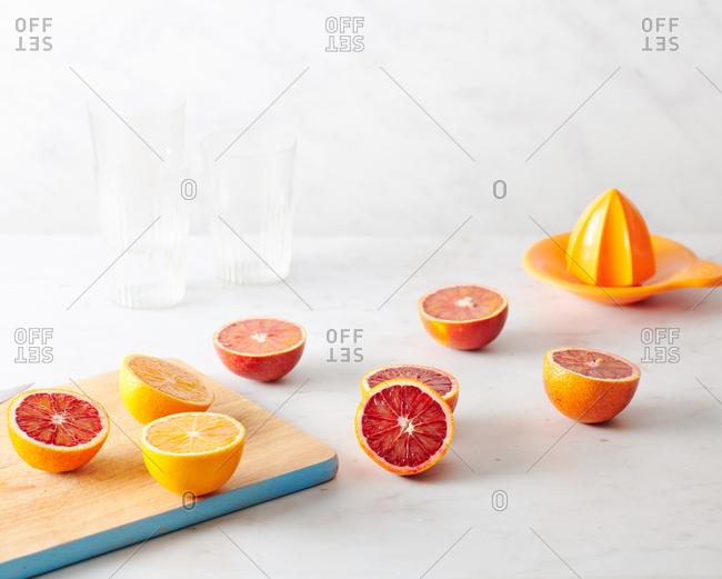 Half oranges on marble work surface in kitchen