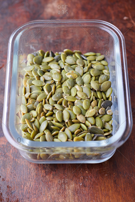 Pumpkin seeds in glass container