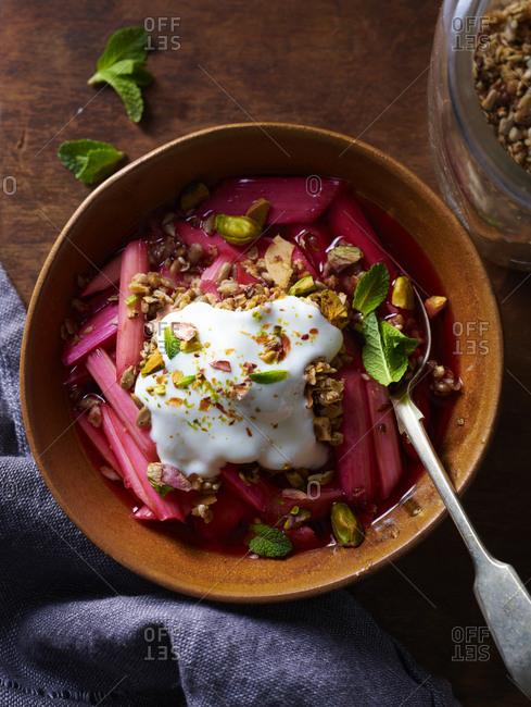 Rhubarb yogurt and granola bowl