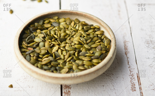 Small bowl with pumpkin seeds