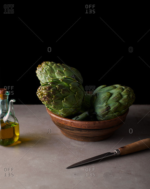 Three artichokes in a bowl