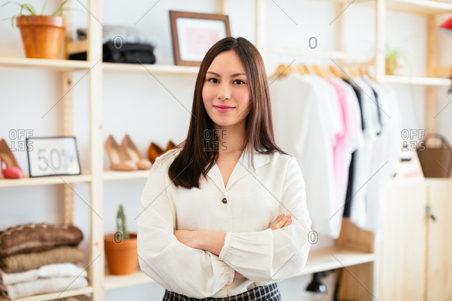 Portrait of confident saleswoman at store.