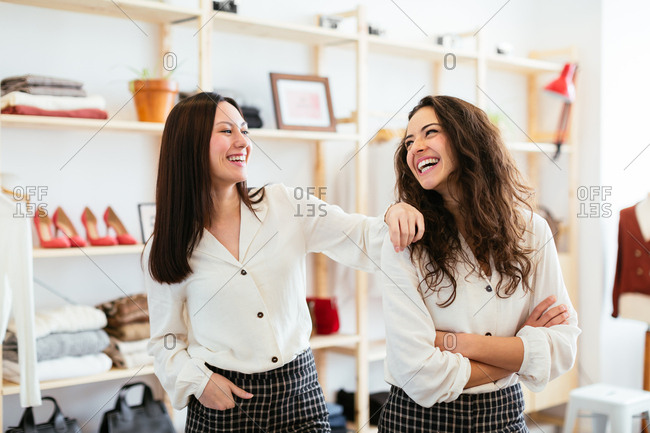 Portrait of young smiling saleswomen at store.