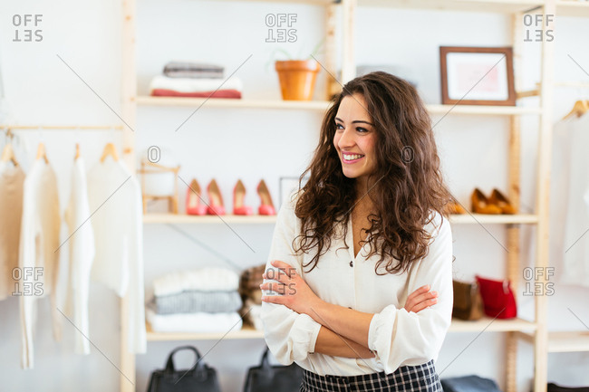 Portrait of smiling saleswoman at store.