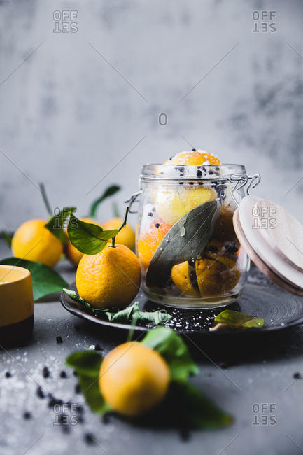 Citrus fruits stored in a glass jar