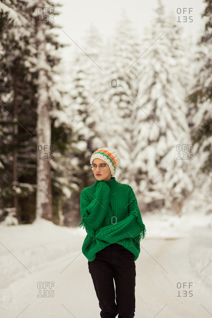 Woman posing in snow covered forest