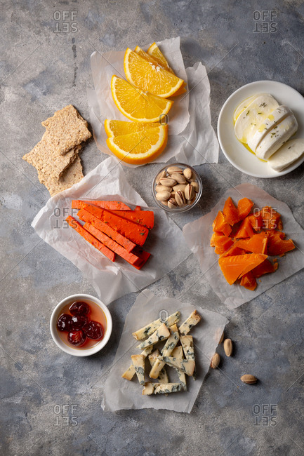 Overhead view of ingredients for cheese plate