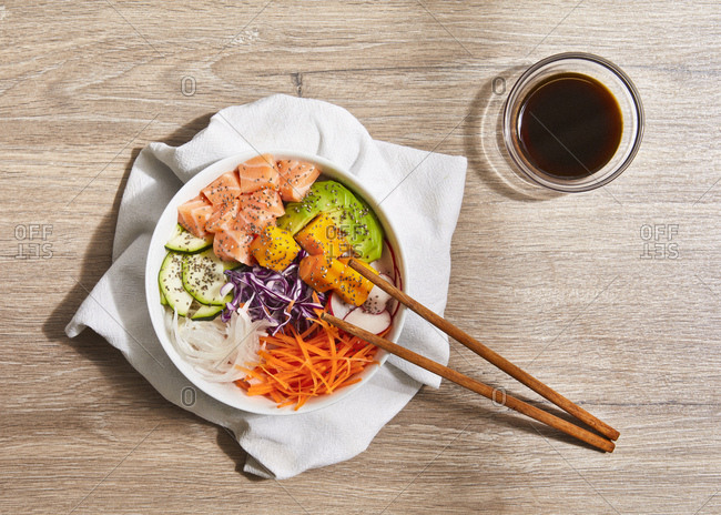 Poke dish with chopsticks and soy sauce.