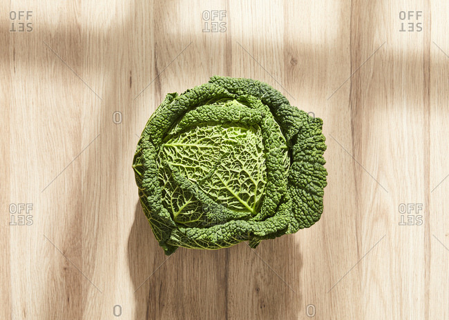 Raw cabbage on a wooden table