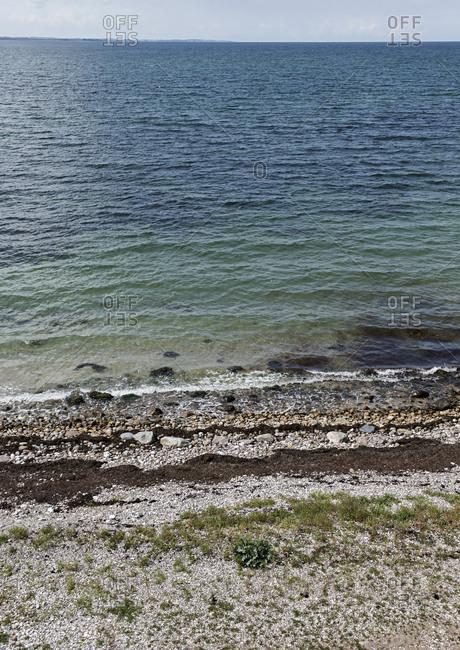 Waves crashing on a rocky shoreline