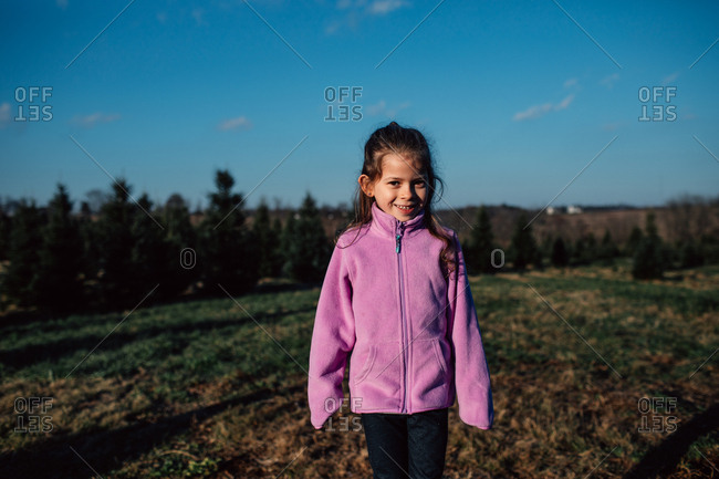 Portrait of a happy little girl in a country setting