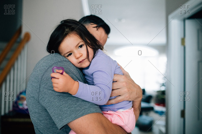 Father comforting toddler girl