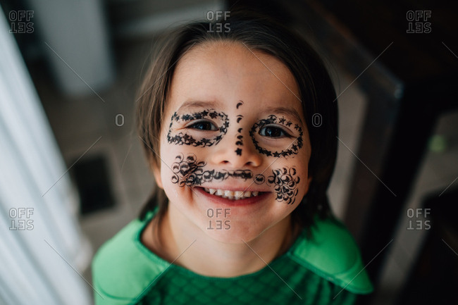 Little boy with stamps all over his face