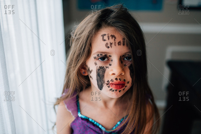 Little girl with stamps all over her face