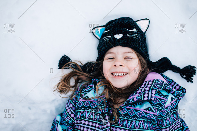 Little girl lying in the snow
