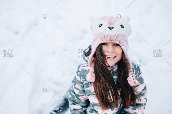 Young girl wearing fox knit hat outdoors in winter
