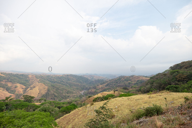 Rolling hills under cloudy sky in the Costa Rican countryside