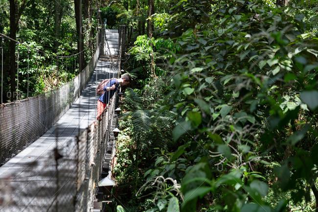 Man on suspension bridge in Costa Rica