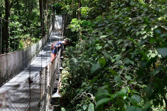 Man on suspension bridge in Costa Rica