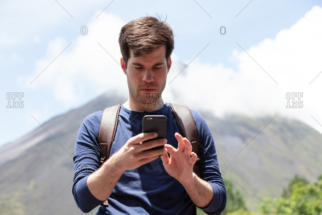 Man using cell phone while hiking in Costa Rica