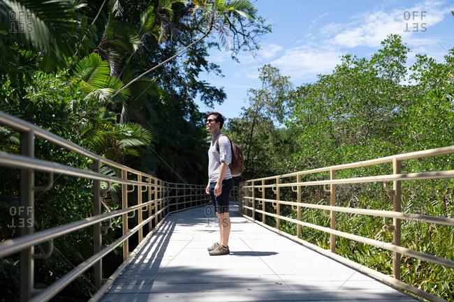 Man walking on path through Manuel Antonio National Park, Costa Rica