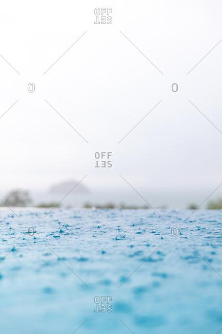 Rain falling in a swimming pool