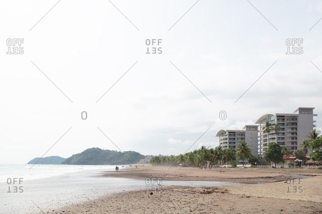 Jaco Beach, Costa Rica - April 14, 2018: Beachgoers on Jaco beach