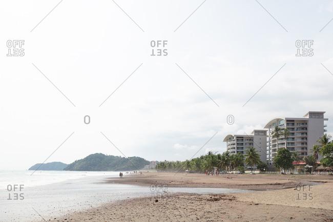 Jaco Beach, Costa Rica - April 14, 2018: Beachgoers on Jaco beach