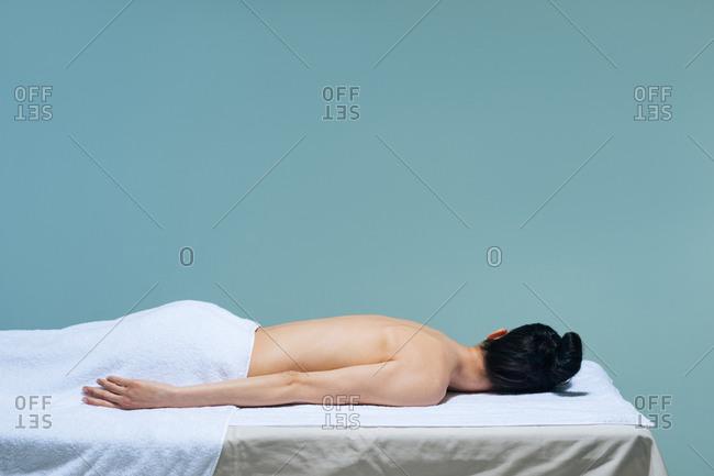 Woman lying on massage table.