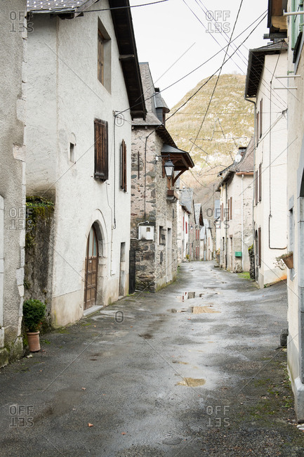 Panoramic view of ancient town near high hills and cloudy in Pyrenees