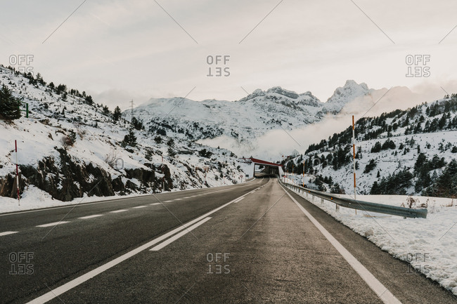 Snowy route running between mountains in Pyrenees