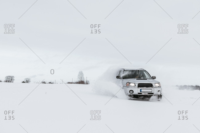 Car driving on snow field
