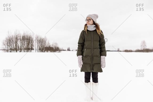 Young woman in winter wear on snow field
