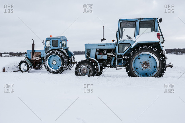 Side view of tractors cleaning snow from meadow in Vilnius, Lithuania
