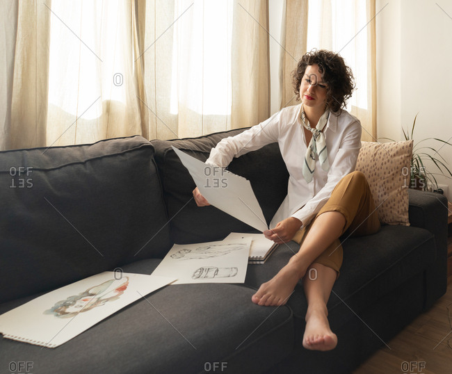 Woman with draws on papers