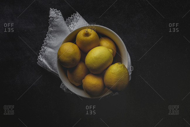 Fresh lemons on dark background. Flat lay. From above