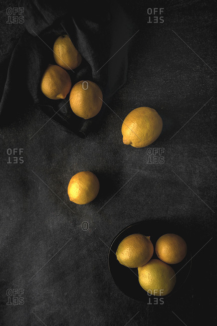 Fresh lemons on dark background. Flat lay. From above