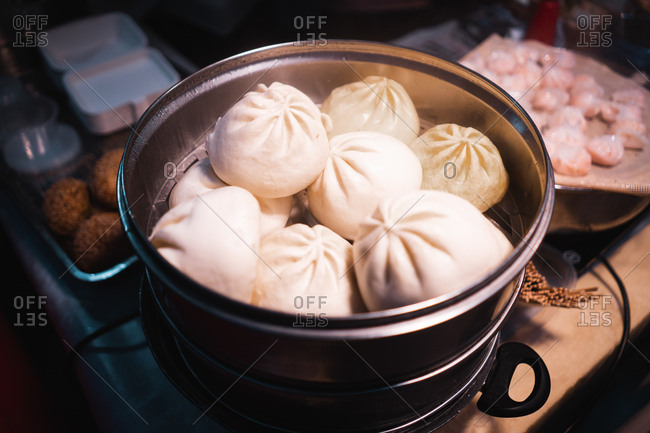 From above set of big meat dumplings in pot near cutting board with fresh minced meat in Auckland, New Zealand
