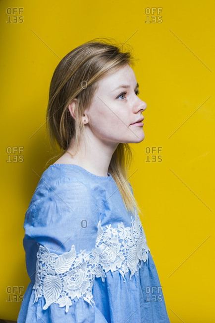 Blonde woman posing in studio